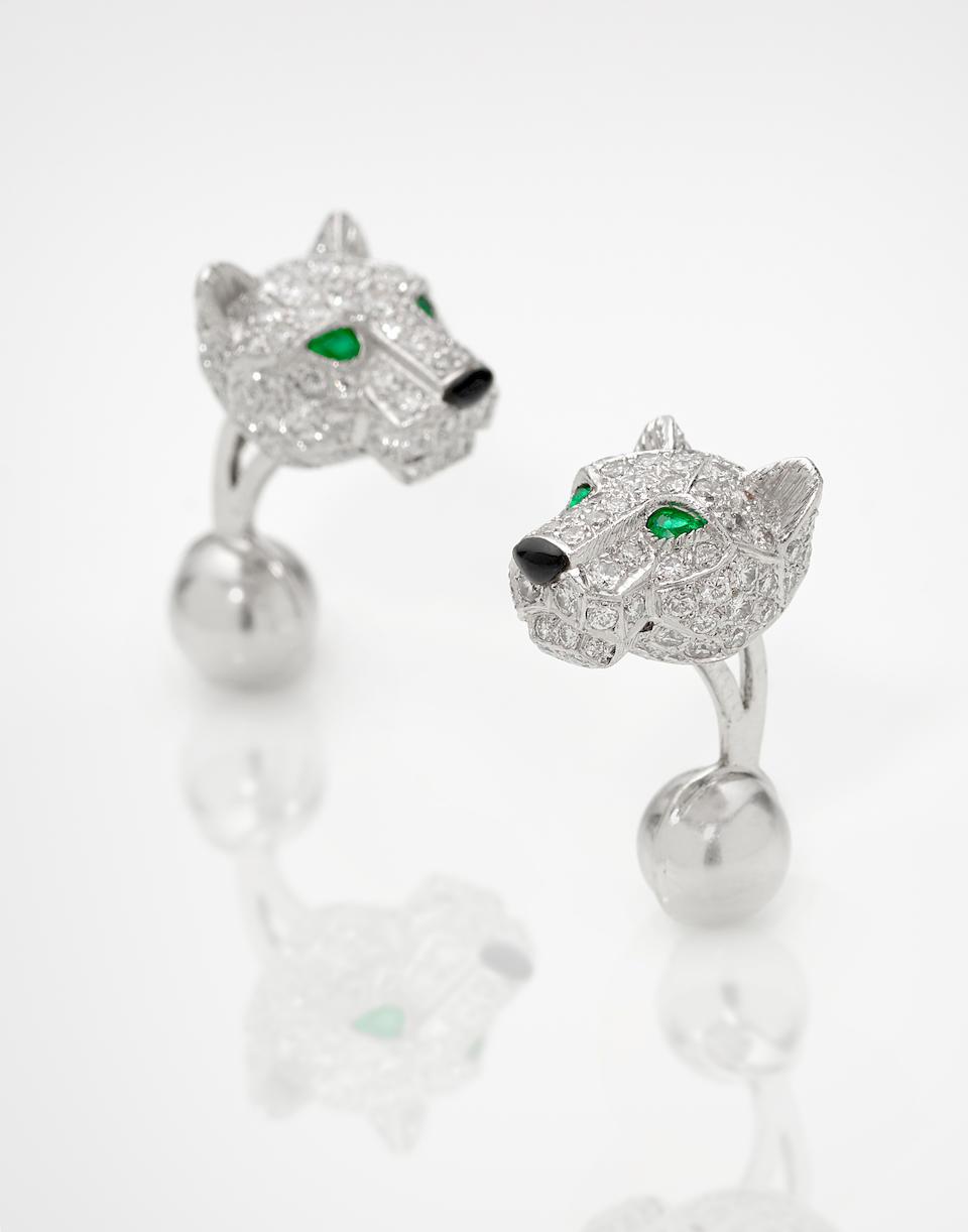 A pair of diamond, emerald, black onyx, platinum and 18K white gold 'Panthère de Cartier' cufflinks, Cartier