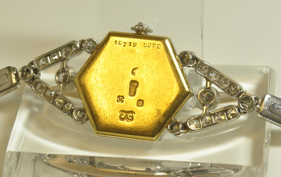 Cartier. A fine early platinum, diamond and gold bracelet watchcase with London import mark for 1919