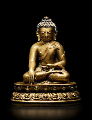 A COPPER INLAID BRASS ALLOY FIGURE OF BUDDHA CENTRAL TIBET, 13TH CENTURY