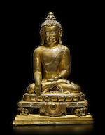 A SILVER AND COPPER INLAID GILT BRASS ALLOY FIGURE OF BUDDHA TIBET, 12TH/13TH CENTURY