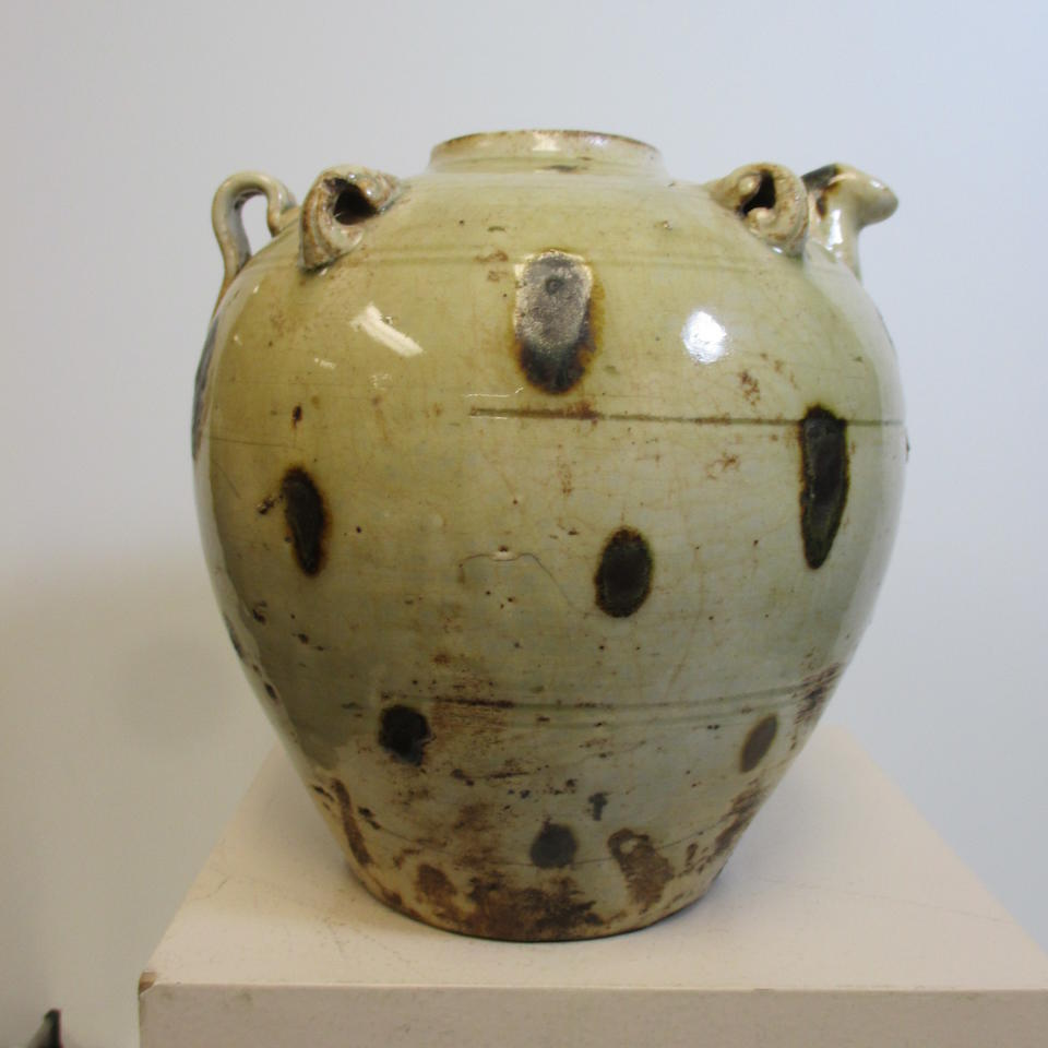 A spotted celadon ewer and lid Tran dynasty, 13th/14th century