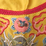 An imperial yellow satin dragon robe embroidered with five imperial symbols 19th century