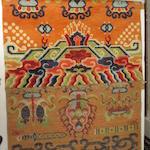A PAIR OF WOOL 'AUSPICIOUS EMBLEMS' PILLAR RUGS Early 20th century