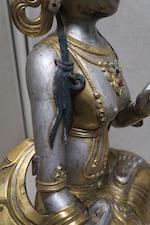 A polychrome and parcel gilt metal alloy repoussé figure of white Tara Circa 1900