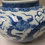 A PAIR OF BLUE AND WHITE 'DRAGON' JARS AND COVERS Jiajing marks, Late Qing dynasty