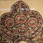 A gilt copper alloy and semi-precious stone inset textile shoulder surround Ladakh, Western Tibet, 19th/20th century