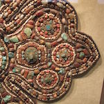 A gilt copper alloy and semi-precious stone inset textile shoulder surround Ladakh, Western Tibet, 19th/20th century