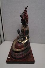 A POLYCHROME LACQUER AND GILT COPPER ALLOY REPOUSSÉ FIGURE OF MANJUSRI 19th century