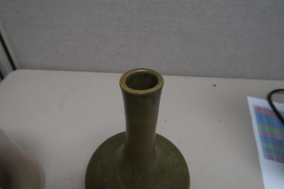 A tea dust glazed long neck vase