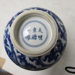 TWO BLUE AND WHITE 'LOTUS' STICK NECK VASES Kangxi period