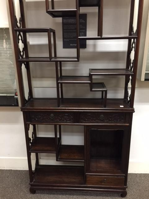 A pair of two-section hardwood display shelves