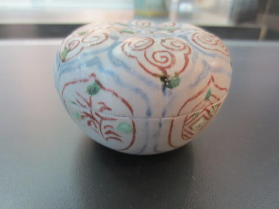 A small covered box with intricately painted underglaze blue and polychrome designs 15th/16th century