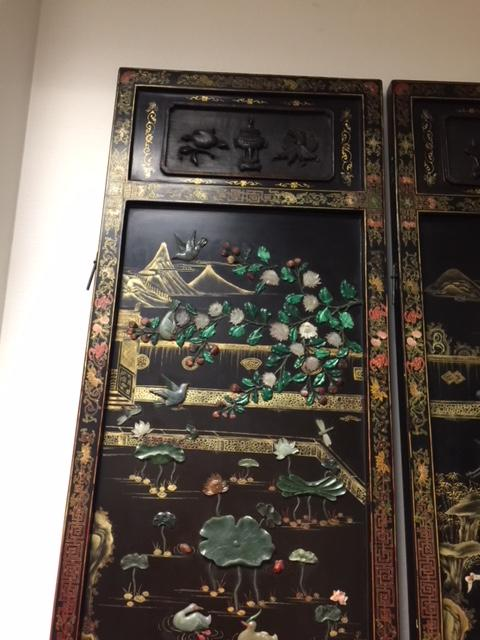 A four panel hardstone overlay lacquer screen  20th century