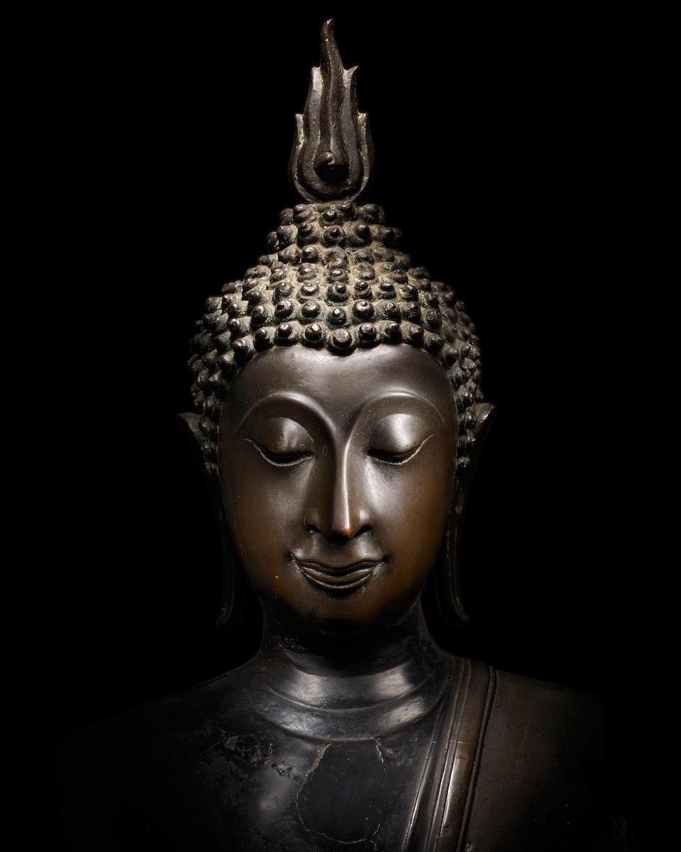 A COPPER ALLOY FIGURE OF BUDDHA THAILAND, KAMPHAENG PHET, CIRCA 15TH CENTURY