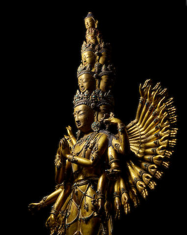 A GILT COPPER ALLOY FIGURE OF AVALOKITESHVARA SAHASRABHUJA EKADASAMUKHA BY SONAM GYALTSEN (A.15TH CENTURY), CENTRAL TIBET, CIRCA 1430