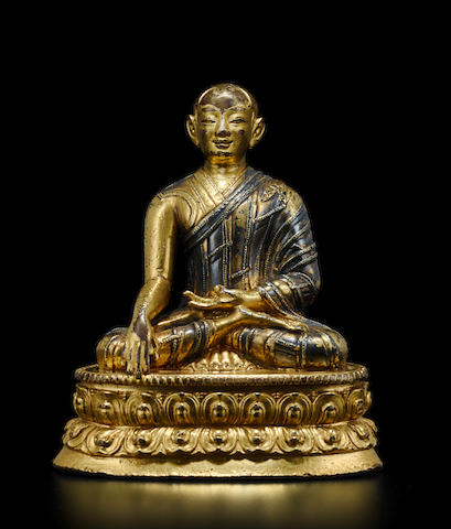A GILT AND SILVERED COPPER ALLOY FIGURE OF JIGTEN SUMGON RINCHEN PEL TIBET, LATE 13TH/14TH CENTURY
