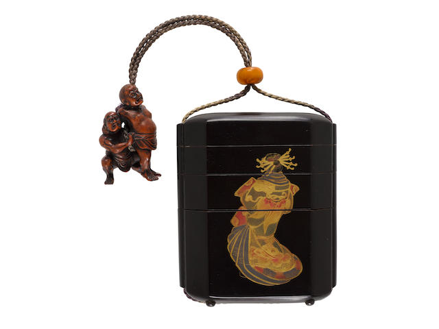 A very large three-case lacquer tonkotsu (tobacco box) with a netsuke of sumo wrestlers Edo period (1615-1868), 18th/19th century