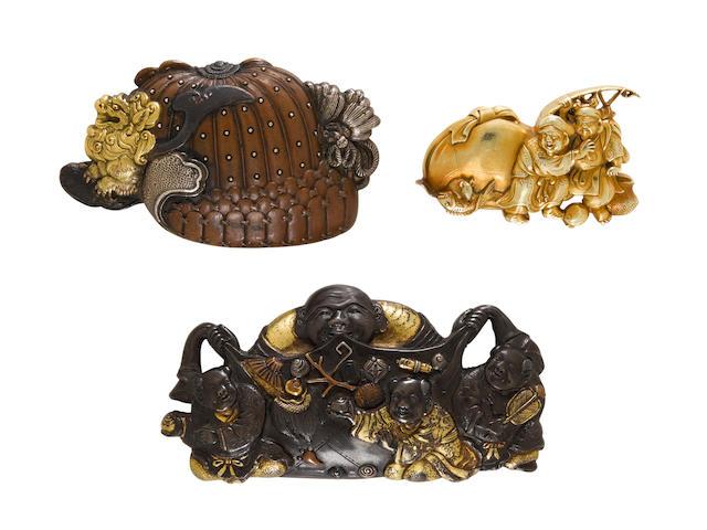 Three kanamono (metal fittings) from tobacco pouches The first by Ujiyuki, Edo period (1615-1868) or Meiji era (1868-1912)