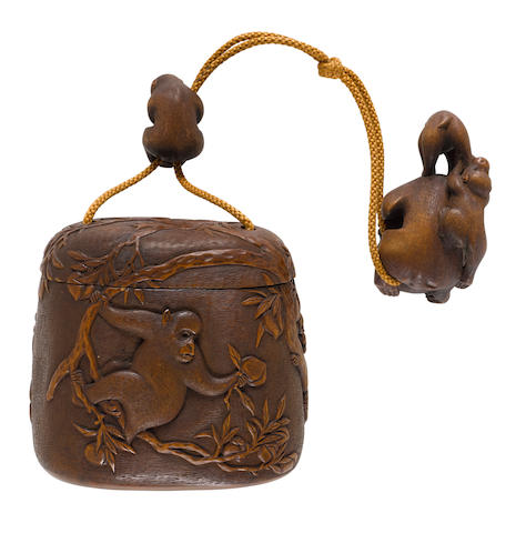 Hidemasa (active 19th century)  A matching wood tonkotsu (tobacco box), netsuke and ojimeEdo period (1615-1868), 19th century