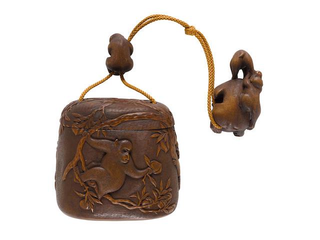 Hidemasa (active 19th century)  A matching wood tonkotsu (tobacco box), netsuke and ojimeEdo period (1615-1868), 19th century