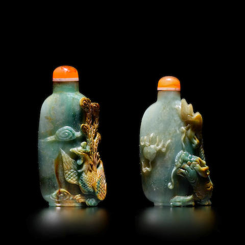 A PAIR OF JADEITE 'DRAGON AND PHOENIX' SNUFF BOTTLES 20th century
