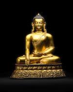 A GILT COPPER ALLOY FIGURE OF SHAKYAMUNI BUDDHA KHASA MALLA, 13TH/14TH CENTURY