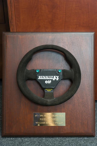 A Personal Formula One Steering Wheel, with plaque inscribed '1st-1991 British Grand Prix, Nigel Mansell, Williams Renault FW14-5'