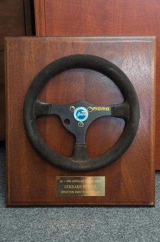 A Momo Formula One Steering Wheel, with plaque inscribed '1st-1986 Mexico Grand Prix, Gerhard Berger, Benetton BMW Turbo'