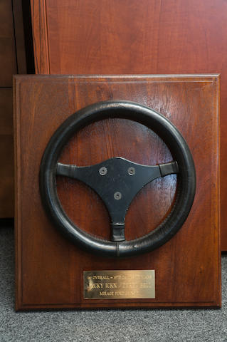 A Steering Wheel, with plaque inscribed '1st Overall – 1975 24 HRS LE MANS, Jacky Ickx. Derek Bell, Mirage Ford GR8-801'