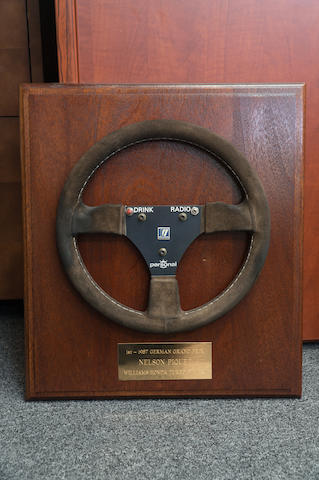 A Personal Steering Wheel, with plaque inscribed '1st-1987 German Grand Prix, Nelson Piquet, Williams Honda Turbo'