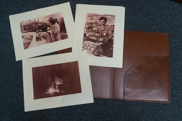 A Ferrari Leather Portfolio – embossed with Maranello 12.10.1982, and including a series of photographs of the Ferrari Factory in this period.