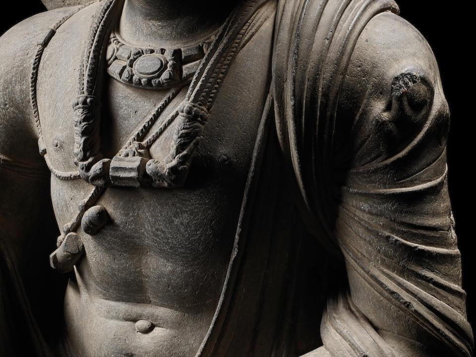 A SCHIST FIGURE OF MAITREYA ANCIENT REGION OF GANDHARA, CIRCA 3RD CENTURY