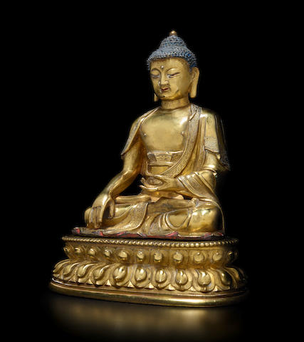A GILT COPPER ALLOY FIGURE OF SHAKYAMUNI BUDDHA QING DYNASTY, 17TH/18TH CENTURY