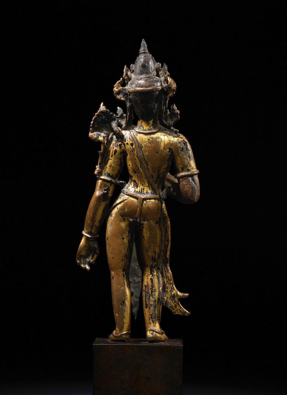 A GILT COPPER FIGURE OF MAITREYA NEPAL, 14TH CENTURY