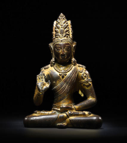 A GILT COPPER FIGURE OF AMOGHASIDDHI NEPAL OR TIBET, 11TH CENTURY
