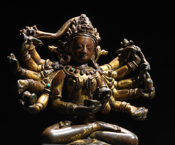 A GILT COPPER FIGURE OF A PROTECTOR GODDESS NEPAL, 14TH CENTURY