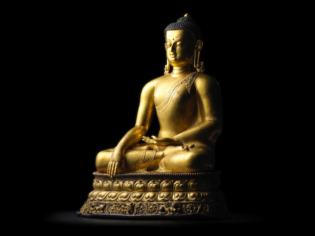 A GILT COPPER ALLOY FIGURE OF SHAKYAMUNI BUDDHA KHASA MALLA, 13TH/14TH CENTURY