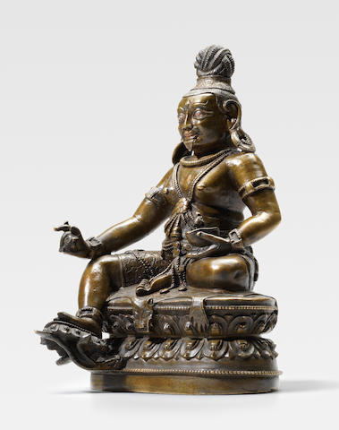 A SILVER AND COPPER INLAID COPPER ALLOY FIGURE OF TSANGNYON HERUKA TIBET, 16TH CENTURY