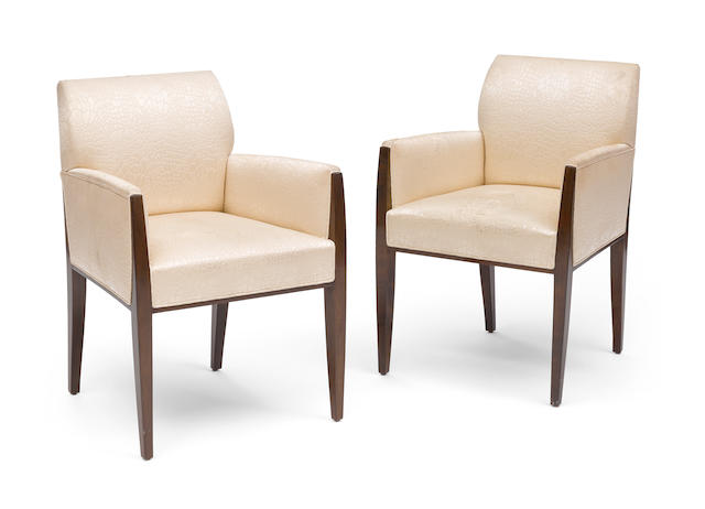 A Pair of Art Deco style upholstered armchairs height 33 3/4in (85cm); width 23 3/8in (59cm); depth 23 1/4in (59cm)