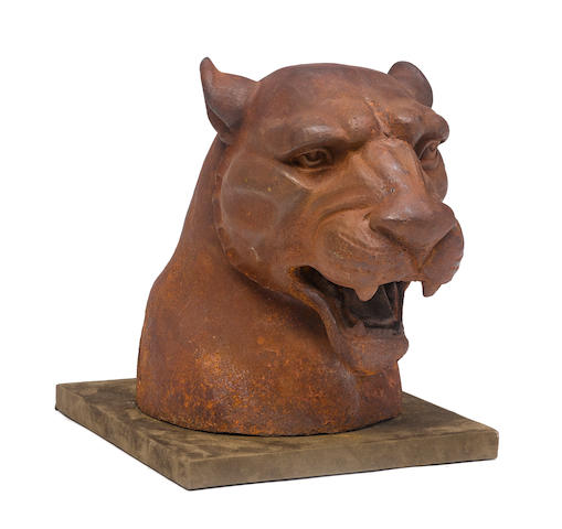 A patinated cast iron sculpture of a Lioness head On integral square base.height 16in (41cm); width 12in (30.5cm); depth 20in (51cm)