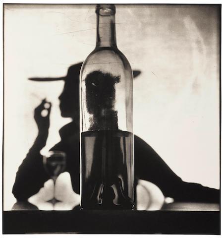 Irving Penn (1917-2009); Girl Behind Bottle, New York (Jean Patchett);