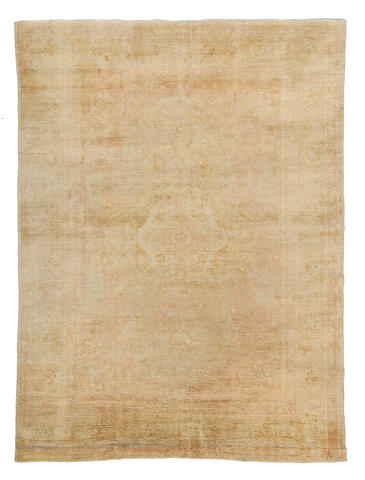 An Oushak carpet West Anatolia dimensions approximately 12ft 2in x 9ft (371 x 274.5cm)