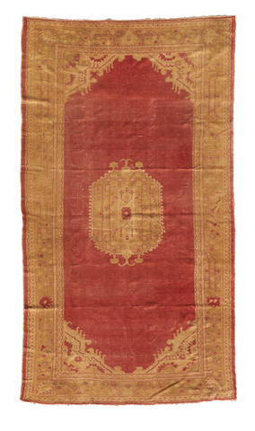 An Oushak Carpet West Anatolia dimensions approximately 18ft x 10ft (549 x 305cm)
