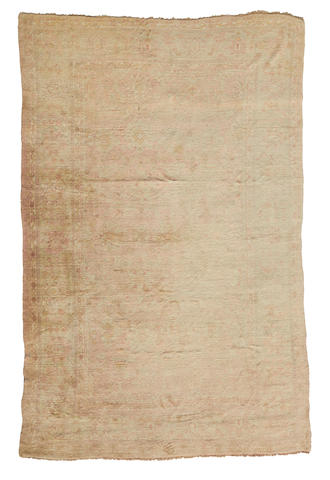 An Oushak carpet West Anatolia dimensions approximately 14ft x 10 ft (427 x 305cm)