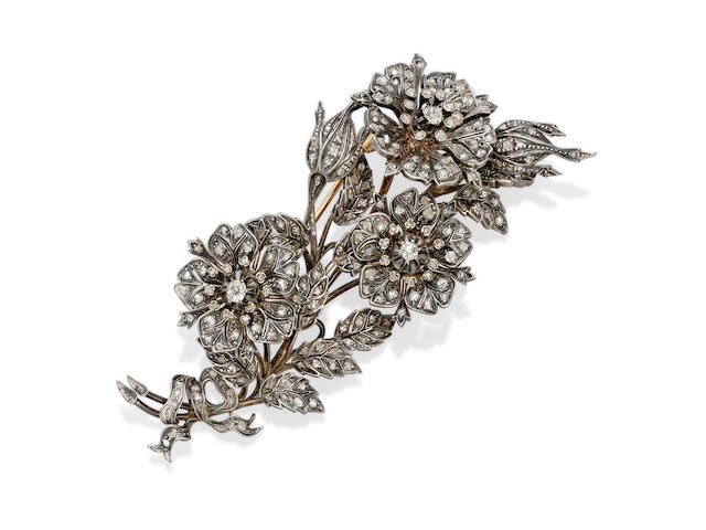 A 19th century diamond and silver-topped gold 'en tremblant' flower brooch