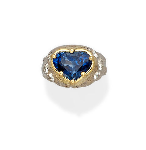 A sapphire, diamond and 18k bi-color gold ring