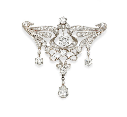 A diamond and platinum-topped gold brooch,