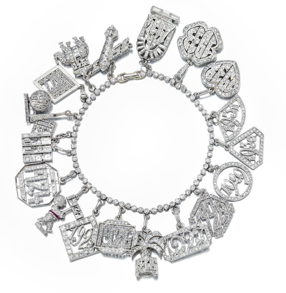 An Art Deco diamond charm bracelet, circa 1925