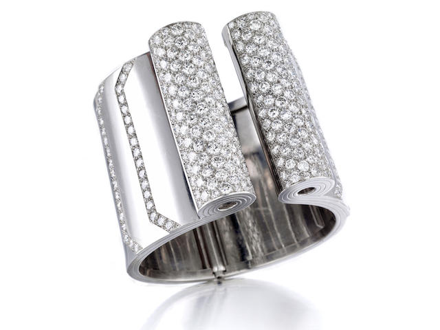 A platinum and diamond bangle bracelet,