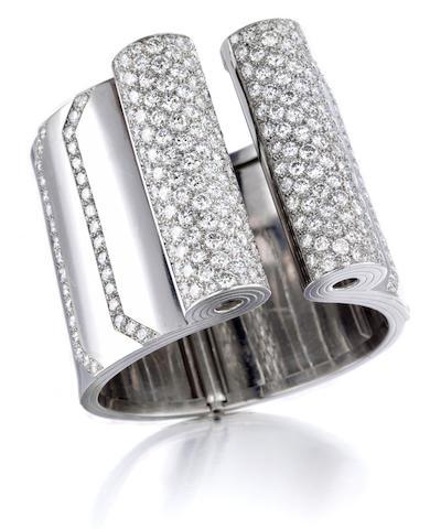 A platinum and diamond bangle bracelet,